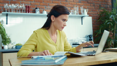 Business woman working with financial report. Accountant girl verifying mistakes Live Action