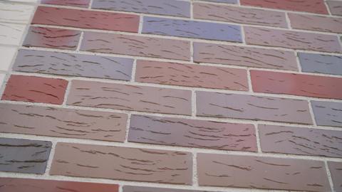 Brick house under construction. Colored brick house under construction. Brick Live Action