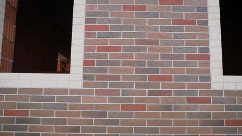 Silicate Brick House. Colored brick house under construction. Colored brick wall Live Action
