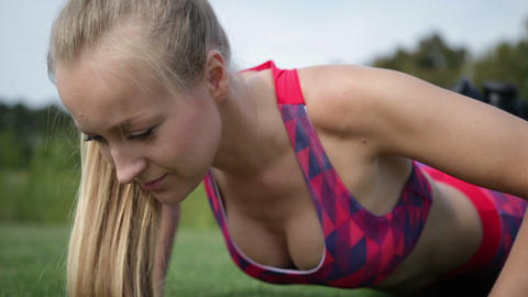 Sporty fit woman exercising by doing push-ups Live Action