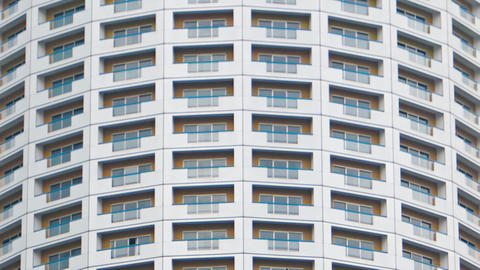 Curved Facade of an Unusual Urban Highrise Building. FullHD video Footage
