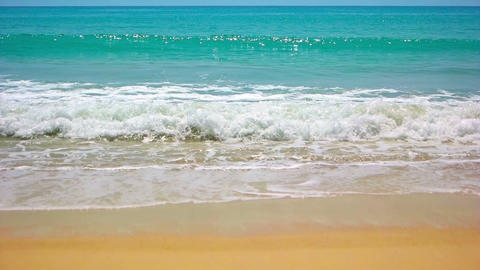 Gentle Waves on a Pristine. Tropical Beach. FullHD video Footage