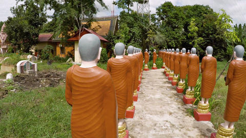 Many Identical Monk Statues at a Buddhist Temple. from Behind. FullHD video Footage