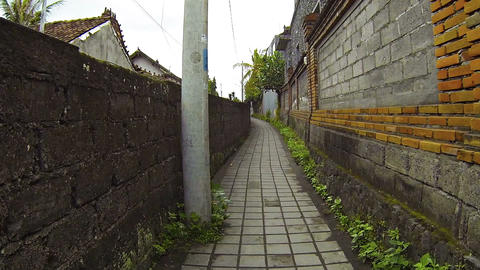 Strolling along a Narrow Walkway between Cement Walls in Southeast Asia Live Action