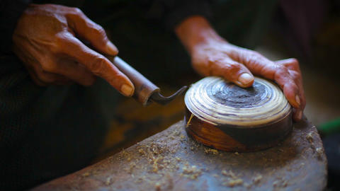 Artisan Handcrafting a Bamboo Cup in a Workshop. Video Live Action