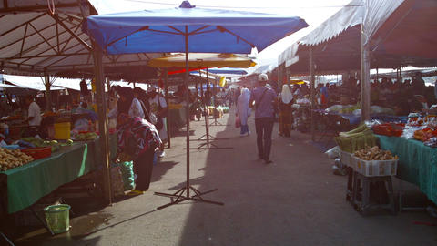 Shoppers buying fresh produce at an outdoor. public market. FullHD video Footage