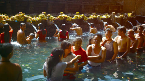 Hindus bathing in the holy springs at Tirta Empul water temple Footage