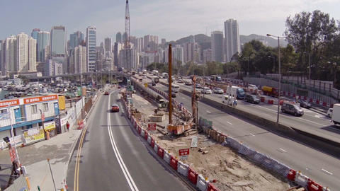 Highway construction with Hong Kong's skyline in the background. FullHD video Footage
