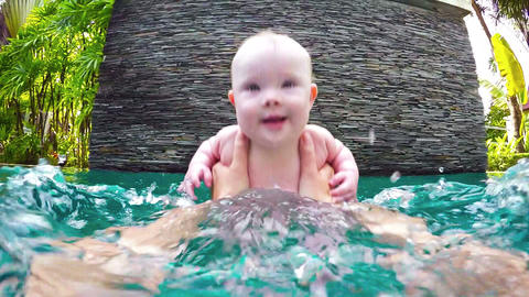 Baby Splashing with Mommy in the Pool. FullHD video Footage