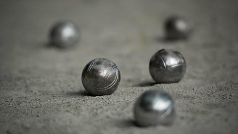 Selective focus shot. Petanque balls on a coarse. sandy play area ライブ動画