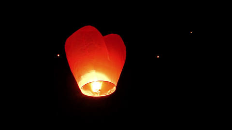 Asian Flying Lantern Ascending into the Night Sky. FullHD video Footage