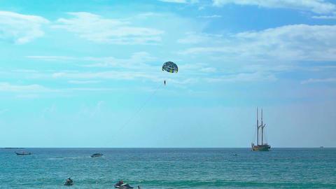 Parasailing Tourist at Tropical Beach Paradise. FullHD video Footage