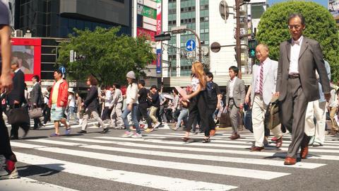 Tokyo - May 2016: People at Shibuya crossing. 4K Footage