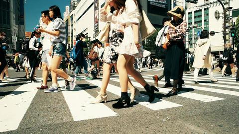 Tokyo- May 2016: People at Shibuya crossing. Slow motion retro look Footage