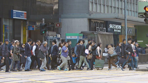 Heavy pedestrian traffic crossing a busy urban street in Hong Kong Footage