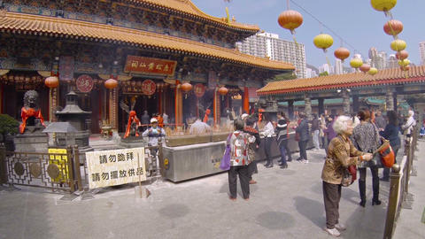 Incense of many worshippers praying outside Wong Tai Sin Buddhist temple Footage
