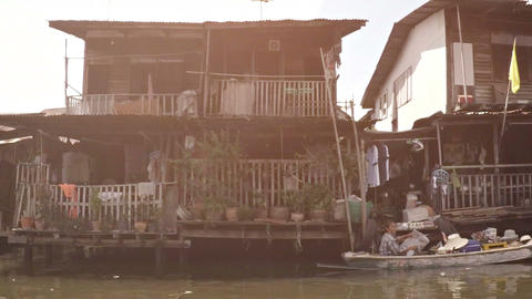 Riverfront community on the Chao Phraya. Video FullHD Footage