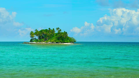 Tiny Tropical Island in Thailand against a Bold. Blue Horizon. Video FullHD Live Action