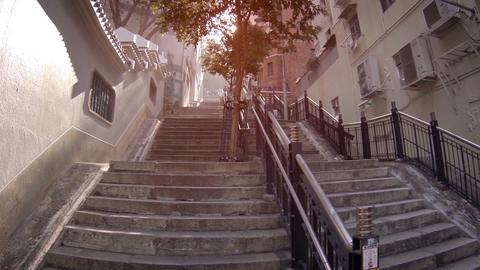 Outdoor stairway provides pedestrian access to hillside between buildings Footage