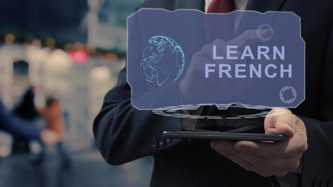 Businessman uses hologram Learn French Live Action