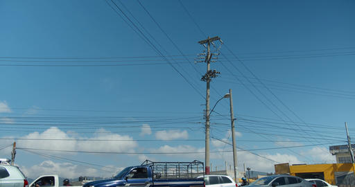Electricity and telephone pole with time lapse traffic in Xela Quetzaltenango Live Action