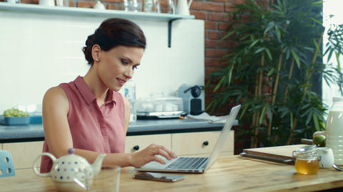 Woman using laptop for video conversation. Girl waving hand to notebook camera Live Action