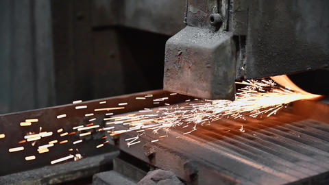 Industrial Processing of metal, grinder with sparks Live Action