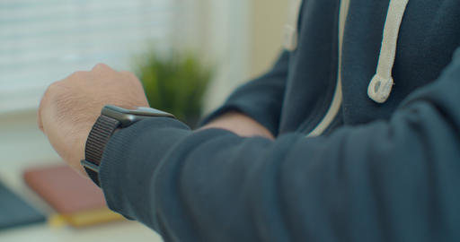 Man hands touching Smartwatch screen to use mobile application. Wearable gadget Live Action