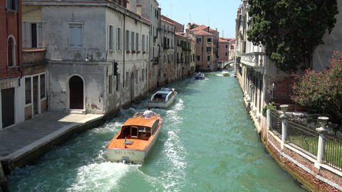 Panoramic view of Venice narrow canal with historical buildings Live Action