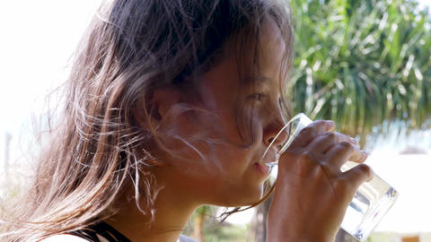 Girl drinking glass of water Live Action