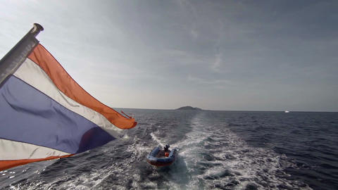 Inflatable Dinghy Towed in the Wake of a Larger Boat Footage