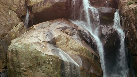Waterfall with several cascades. Vertical panning Footage