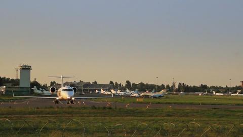 Utair Airlines Canadair CL-600 turning on runway Footage