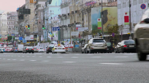 Time-lapse city street at daytime, cars drive fast, low angle Footage