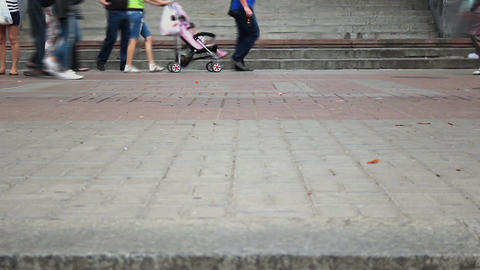 Time lapse of different people walking on city pavement tiles Footage