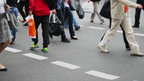 Business people walk on crossroad pedestrians, city daytime Footage