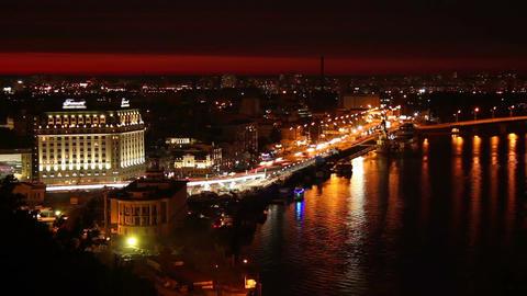 Night city quay, ferry boat docking, city lights, cars Footage