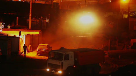 Construction yard night shift, trucks work driving, building Footage