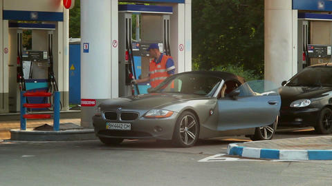 Classy elite car drives to gas fueling station, gasoline petrol Footage