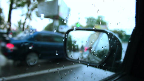 Rainy day inside car view wet road drops on window Footage