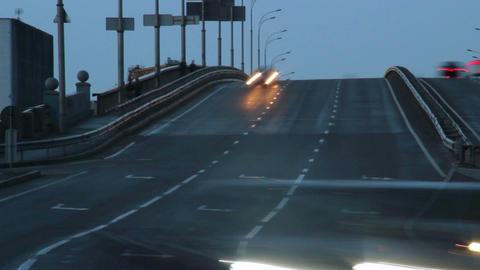 Car timelapse dusk, long light traces, driving city vehicles Footage
