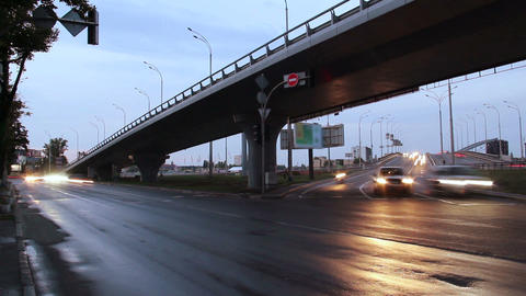 City traffic road junction, bridge highway, car lights turned on Footage