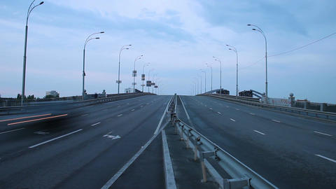 Timelapse of highway road junction, city vehicles pass lights on Footage