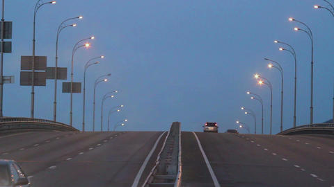 Dense evening traffic, cars drive lights dusk city highway road Footage