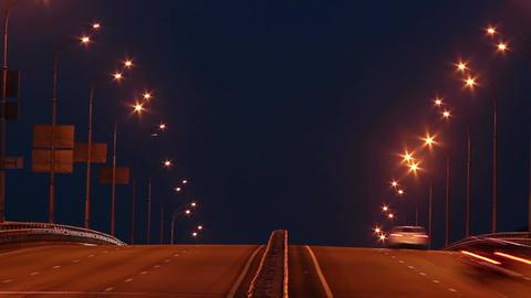 Timelapse of bridge highway traffic, dusk cars drive lights on Footage
