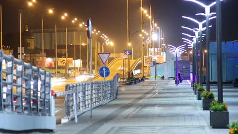 Pavement people walking night in city sidewalk cars driving road Footage