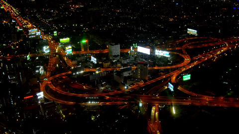 Night Time Cityscape shows Lighted Traffic on Busy Highway Junction Footage