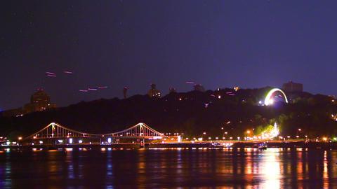 Night city scape, shining lights, boats, air traffic stars shine Footage