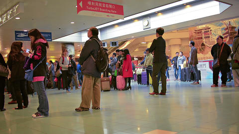 Passengers waiting in line at the boarding gate. inside Hong Kong Airport Footage