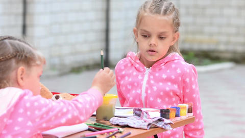 Girl chooses and displays the correct pencil another girl who abandons him Live Action